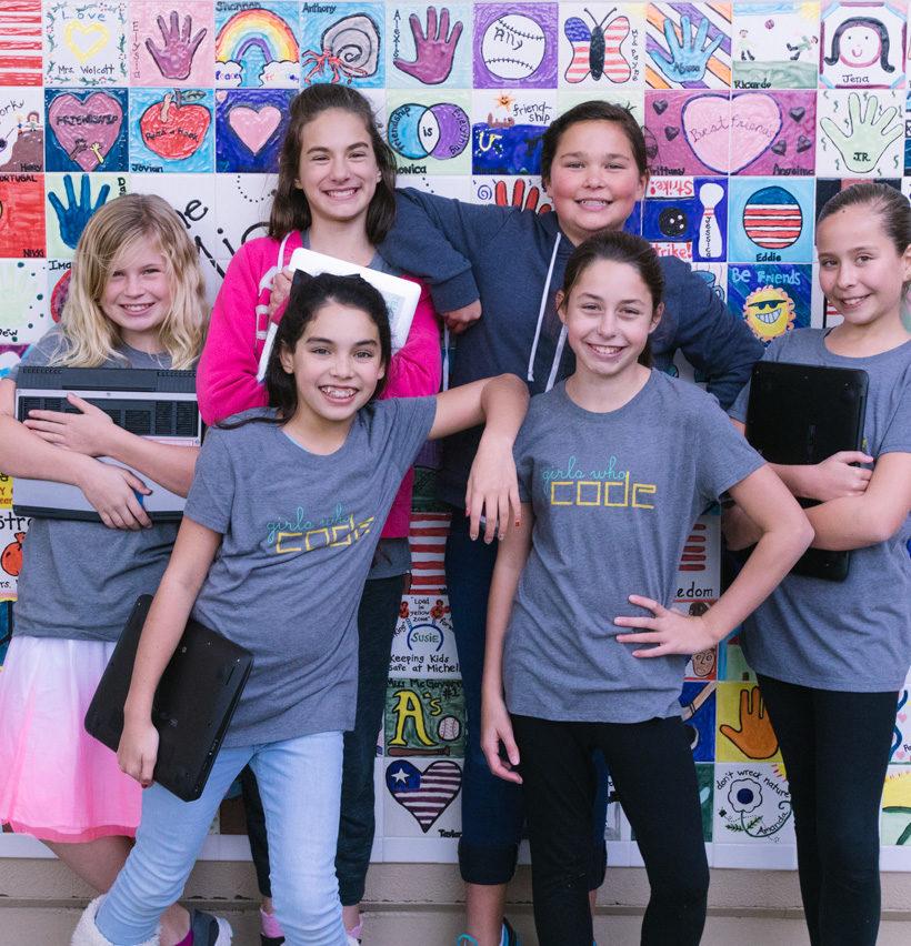 Six girls wearing Girls Who Code Tshirts