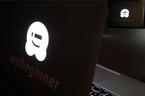 WHOOPS.ONLINE branded laptop